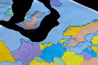 A torn paper map symbolizing the UK leaving the European Union or Brexit