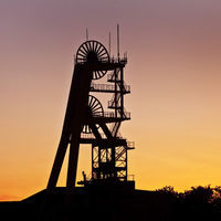 Headframe of Ewald colliery at sunset, Herten, Ruhr area, North Rhine-Westphalia, Germany, Europe