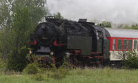 Historic steam locomotive with passenger wagons