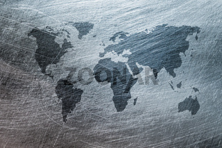 grunge map of the world over brushed metal texture