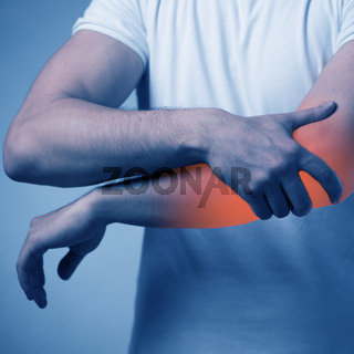Man suffering from acute pain in elbow
