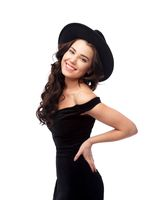 Portrait of a beautiful lady wearing a black hat and evening dress