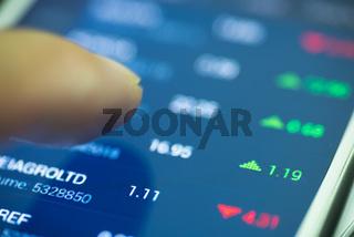 stock market application on touchscreen smartphone