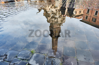 Cobblestone brick paved wet street at Piazza Navona