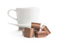 Sweet nougat pralines and coffee cup.