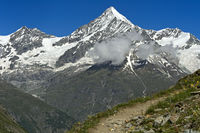 The Weisshorn peak rises above the Mattertal valley, Täschalp, Valais, Switzerland