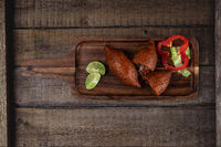 Arabic meat appetizer kibbeh on rustic wooden table