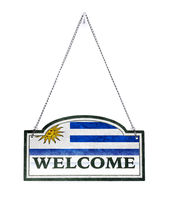 Uruguay welcomes you! Old metal sign isolated
