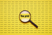 fine print enlarged with magnifying glass magnifier loupe