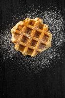 Belgian waffles sprinkled with sugar.