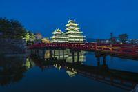 Matsumoto Castle with the red bridge night in Matsumoto, Japan
