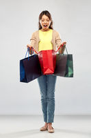 happy asian woman with shopping bags