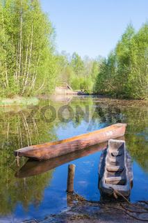 Dougout canoes on a lake