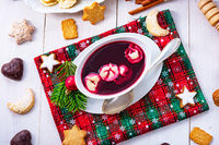 Barszcz (beetroot soup) with small pierogi
