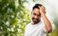 indian man touching his hair