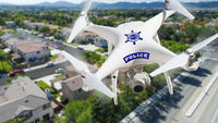 Police Unmanned Aircraft System, (UAS) Drone Flying Above A Neighborhood and Street