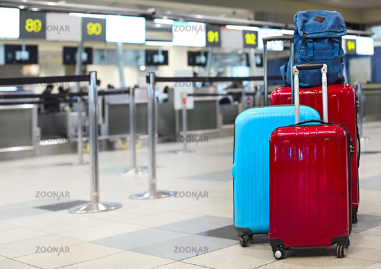 Stack of travelers luggage in airport terminal