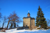 BROUMOV, CZECH REPUBLIC - MARCH 9, 2010: The Star Chapel in the hills above the town of Broumov