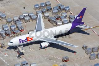 FedEx Express Boeing 767-300F airplane Los Angeles airport aerial view