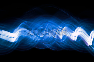 Sound waves in the dark in blue color