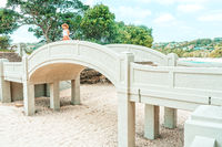 Woman standing on arched bridge at Balmoral Beach