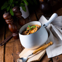 Veal goulash with baked aubergine and herbs