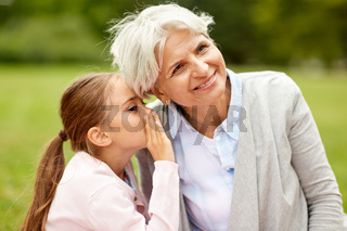granddaughter sharing secrets with grandmother