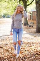 teenage girl enjoying walk on sunny day in autumn