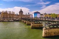 Paris France city skyline at Pont des Arts Bridge and Seine River