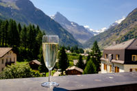 Champagne glass on mountain village background