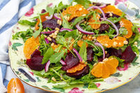 Salad of arugula, baked beets and tangerines.