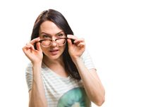 Woman with her glasses lifted up can't see