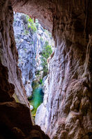 The Tinted Cave offers a window out to the Mares Forest Creek Canyon