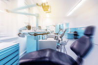 dental clinic interior with dentist chair and modern blue dentistry equipment  -