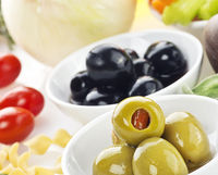 Green and black olives with pasta and vegetables