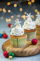 Vanilla cupcakes with Christmas decor.