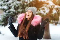 Young beautiful woman at winter city