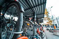 Many bicycle in a row. Bicycle parking at the street