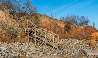 Old wooden stairs down to the sea