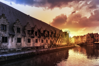 Ghent, Belgium - March 28, 2019: The Vleeshuis or Butcher's House as seen from the river Leie