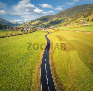 Aerial view of the road in mountain valley. Top view