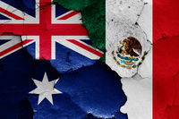 flags of Australia and Mexico painted on cracked wall