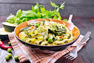 Tagliatelle with green vegetables on napkin
