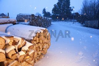 Firewood near a road at evening light