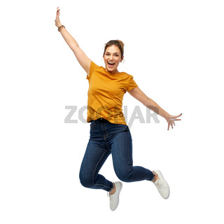 happy young woman or teenage girl jumping