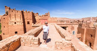 Woman on travel at Ait Benhaddou kasbah, Ouarzazate, Morocco.