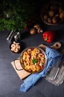 a delicious fried potato and shrimp pan