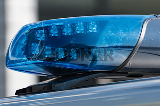 Detail shot of a blue light on a police car