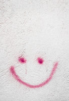 Grungy smiley on wall