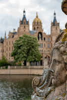 View at Schwerin castle with selective focus on foreground and historical castle in blurry background.